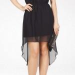 geniş yakalı kolsuz siyah renkli mini etekli arkası uzun etekli şifon kaplı şık adil ışık abiye elbise modeli.